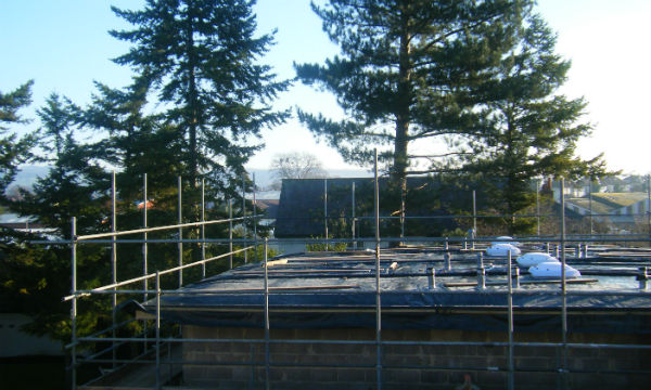 The roof is nearly finished!  Lots of activity inside - its really taking shape!